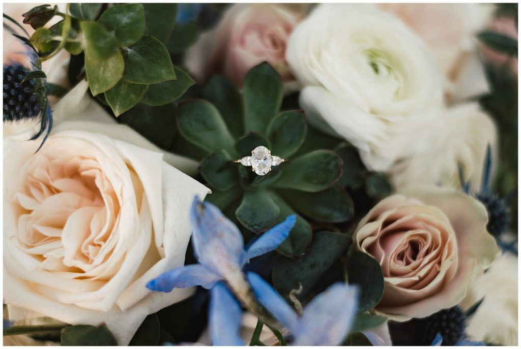Utah photographer captured engagement ring placed in wedding bouquet flowers