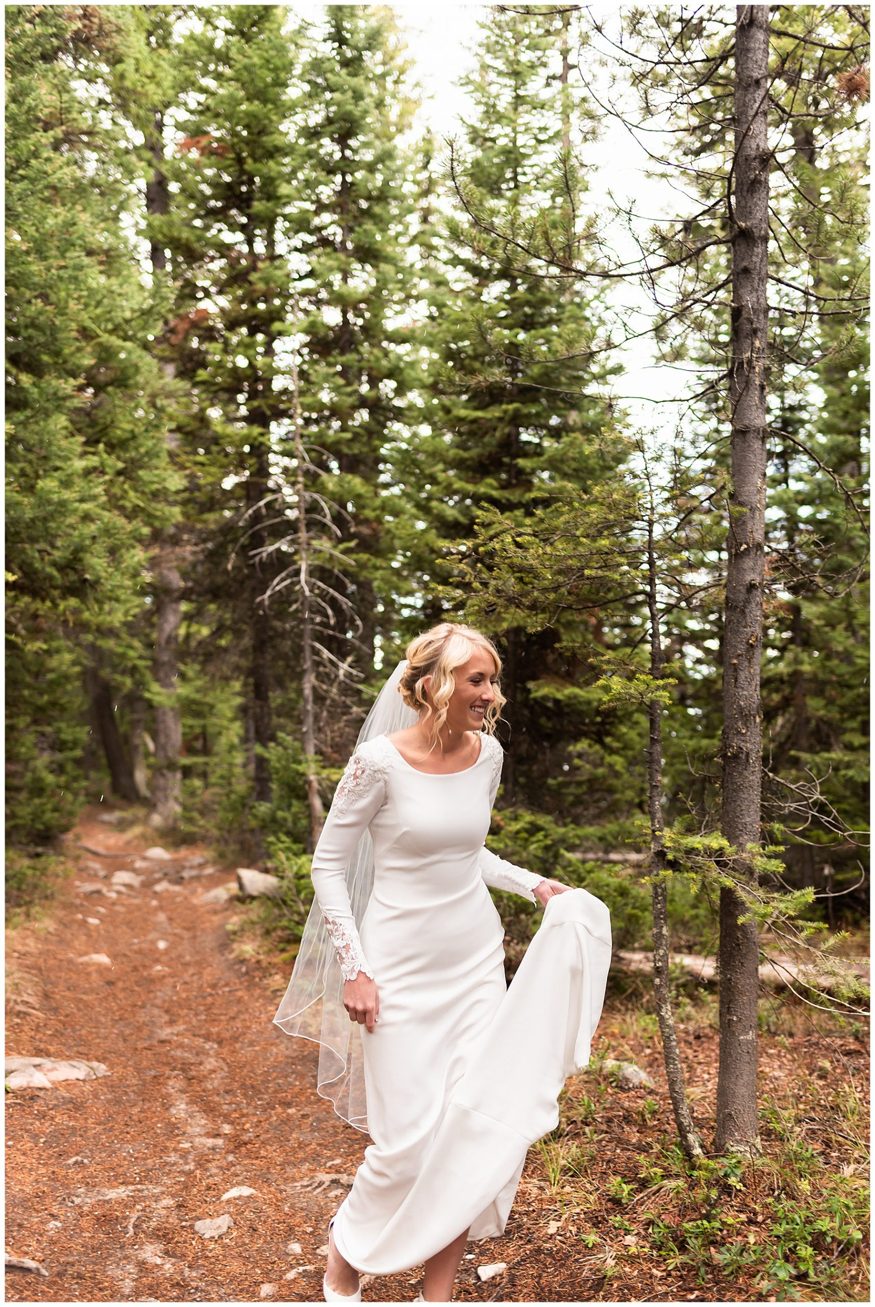 Bride walking down a wooded path, awaiting her first look session with her groom
